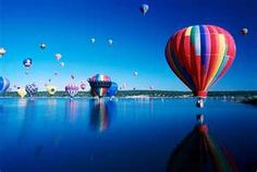 Baloons over water
