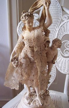 love this statue with lace appliques