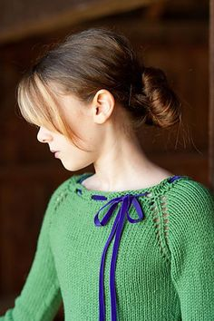 This sweater is knit in the round from the top down using raglan shaping. The raglan increases are formed by making yarnovers which create decorative holes along the raglan seams. The sleeves have a gentle bell shape finished with a simple garter stitch at the cuff. The little patch pocket is an optional addition.