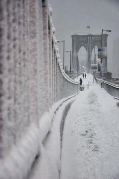 Brooklyn Bridge during Winter Snow fall, NewYork, USA