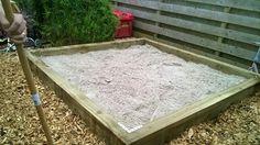DIY sandpit from railway sleepers.
