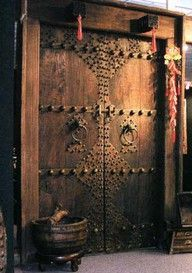 Beautiful Moroccan double door with oversized rivets.