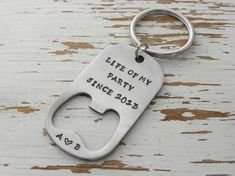 Bottle opener key chain  life of my party by WhisperingMetalworks
