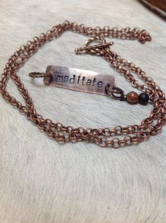 A personal favorite from my Etsy shop https://www.etsy.com/listing/213706250/meditate-stamped-copper-necklace-with