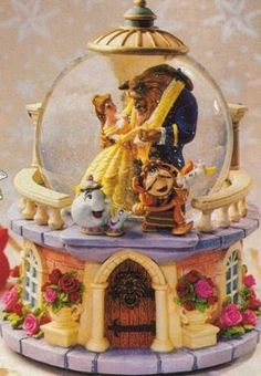 Scan from the Disney Catalog Beauty and the Beast Description: Belle and the Beast waltz the night away, as Cogsworth, Lumiere and Mrs Pot...