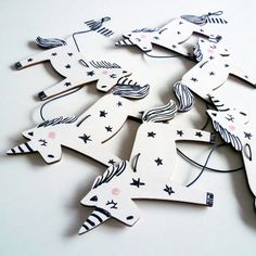Wooden Unicorn Garland by Foxella and Friends, available at Bobby Rabbit.