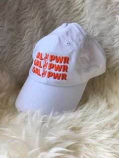 GRL PWR Baseball Cap Available in white with orangey/pink embroidery Embroidered in USA 10% of proceeds donated to Planned Parenthood