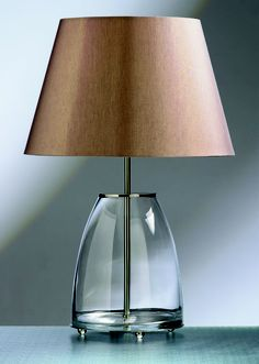 Clear glass lamp base.  http://www.worldstores.co.uk/p/Elstead_Round_Glass_Lamp.htm