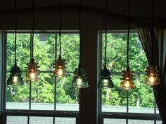 Seven Light  Insulator Chandelier with wood ceiling mount.