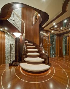 Benetti Yachts Latitude (ex Latinou) Main Deck www. The deck in this image reflects the curve of the stairs as they contact the floor. as well as alining the wood grain of the floor to radiate out as if shafts of light. Escalier Art, Escalier Design, Luxury Yacht Interior, Boat Interior, Modern Staircase, Staircase Design, House Staircase, Stair Design, Home Living
