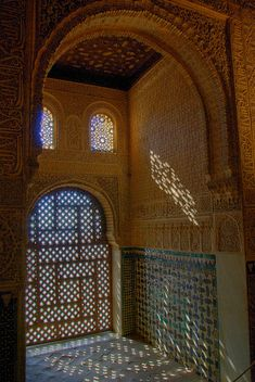Interior with window grill, Alhambra   Reminds me of Moroccan setting of Garment of Shadows by Laurie R. King.