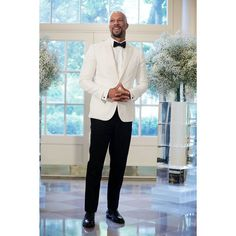 Rapper Common arrives at a Nordic State Dinner May 13, 2016 at the White House in Washington, DC. in white and black tuxedo. | essence.com