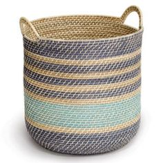 """With a cool blue and organic beige color palette, Palecek's tall Rio basket features a traditional design yet thoroughly modern style. This hapao weave rattan accessory organizes and stores with coastal panache. 18""""Diameter x 18""""H with 3""""L handles."""