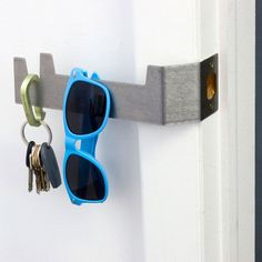 Never lose your keys again. The stainless steel Strikey by Objeti, which happens to be shaped like a key itself, fixes on to the doorjamb and over the lock as a place to hang your keys, sunglasses and anything else you can't leave the house without. $26 on Fab.com (40 retail)