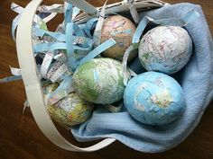 Plastic Easter eggs covered in maps.