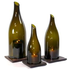 This set includes one each of our Lora/Linn Hurricane Lanterns 750 milliliter, liter and 3 liter size. Our re-purposed hurricane lanterns are Wine Bottle Lanterns, Wine Bottle Art, Bottle Candles, Diy Bottle, Wine Bottle Crafts, Bottles And Jars, Glass Bottles, Wine Candles, Bottle Lamps