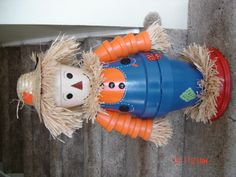 Scarecrow Made From Clay Pots ~ No instructions, looks like it might be easy to figure out though.