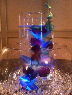 Modern Wedding Centerpiece - A LED light beneath a purple & blue calla lily submerged under water!