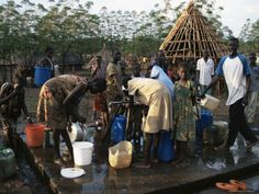 Women Collecting Water at the Dimma Refugee Camp in Ethiopia Africa