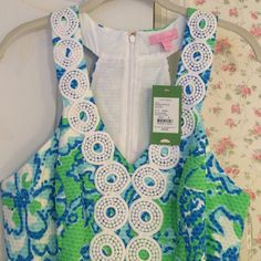 NWT Lilly Pulitzer Dress. Style is Trudy shift in go go green. Has a lining. 100% cotton. Machine wash. Colors are blue, green and white. Has white lace around the neck and down the front. Lilly Pulitzer Dresses