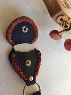 Guitar Pick Buddy makes a perfect gift! Order today! Handmade with fine leather.  A unique gift made to last. by EncoreLeatherDesigns on Etsy https://www.etsy.com/listing/259578462/guitar-pick-buddy-makes-a-perfect-gift