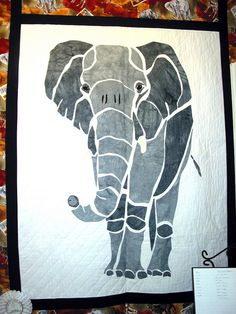 "An idea that could be adapted to variation of  grey/charcoal 2"" blocks like the giraffe? Hmm, maybe......"