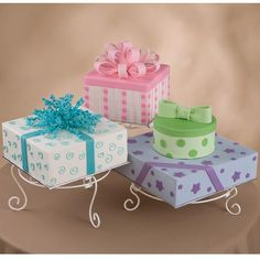 "Surprise Packages Cake - What a great way to celebrate a party! Have the cakes be part of the ""gifts"". Thanks to the easy and flexibility of Ready-To-Use Gum Paste and Fondant, ribbons, bow and appliqués are easy to create and assemble."