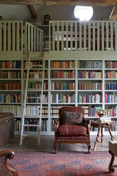 What's not to love about a library room w/ a loft, lots of natural lighting, & shelves stocked full of books? We just adore the rung ladder & big comfy chair, too!
