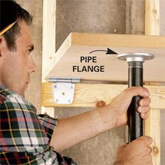 Use a solid-core door, IKEA desk top or 3/4 in plywood for a work surface. Screw 2x4 to wall. Install heavy duty hinges. Add pipe flanges and threaded pipe and you have a fold down workspace.
