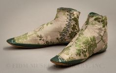 Pale green iridescent silk damask evening boots with green leather foxing at heel and toe, 1850-55.
