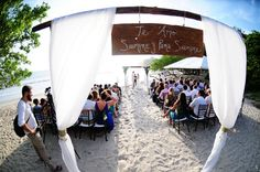 Beautiful Ceremony set up with custom aisle sign. Planner: Meghan Cox, Our Costa Rica Wedding / Photographer: El Velo