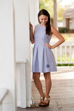 A preppy fave!!!  This dress is perfection for Easter!  Looks amazing with a cardigan or wear it alone!  Flattering fit with A-line skirt - gorgeous details!  Add a monogram for the ultimate preppy look!  Sizing:Small (0-4)Medium (6-8)Large (8-10)  X Large (12-14)-Seersucker Material-Back Zipper-Sleeveless -A-Line FitWill be monogrammed in the font shown in choice of light blue, navy or white.First, LAST, Middle - please enter as you would like sewn!