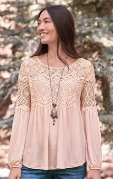 Crochet inset and lace at the neckline gives our hi-lo top a distinctly feminine elegance.