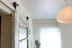 How to make your own sliding door hardware http://www.lynneknowlton.com/diy-door-track-hardware-its-dbomb-dot-com/