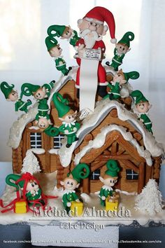 Gingerbread house, Santa, many elves by Michael Almeida Cake Design