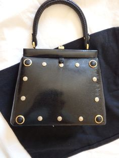 vintage GIANNI VERSACE  The bag is of the first 90 years. exotic iguana skin