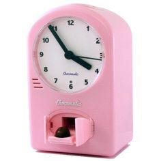 Juat what I need a clock that delivers chocolate to me! Chocolate Clock Chocomatic