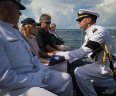Beautiful, Moving Photos From Neil Armstrong's Burial At Sea   Neil's widow, Carol Armstrong, is given his flag.