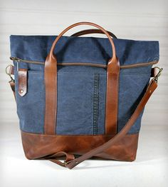 Canvas & Leather Foldover Tote Bag by R. Riveter on Scoutmob Shoppe. A fold over bag can keep expanding when you buy more stuff. Dig this canvas bag made from recycled military tents...
