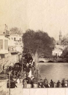Photograph by S.Hakim 1870's. of Damascus. The crowd gathered, most propably on a Friday, picnicing along the banks of Barada River and over...