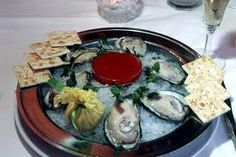 Raw oysters - they are like backward loogies.  Can't do 'em.