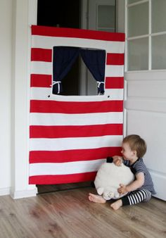 Tension rod hanging puppet theater--turn a hallway into a play space--brilliant!