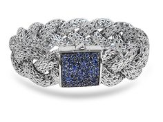 From John Hardy, this Sterling Silver Classic Chain Eighteen MM Large Braided Bracelet Features a Clasp of Blue Sapphires