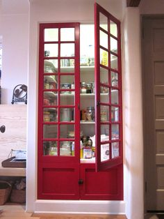 Colorful Pantry Doors  Don't be afraid to show off your personal style in the kitchen with a bright hue, like the red on this salvaged pantry door.