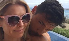 Kelly Ripa gets a kiss from husband Mark Consuelos on vacation