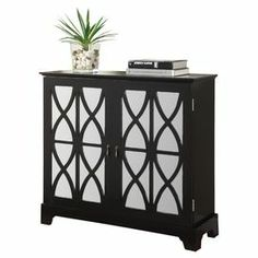 """2-door wood cabinet showcasing mirrored doors with lattice overlay. Product: Cabinet    Construction Material:  Wood and mirrored glassColor:  Black  Features: Glass mirrored doors with curved pattern  Two doorsAmple storage space Dimensions:  35.5"""" H x 38"""" W x 13"""" D  Note:  Door requires assembly"""
