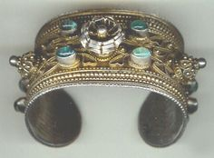 Caucasian cuff,  gilt silver with inlaid glass, Daghestan late 19th c (archives sold Singkiang)