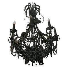 Take a simple black chandelier, add lots of black bling, fun and easy DIY