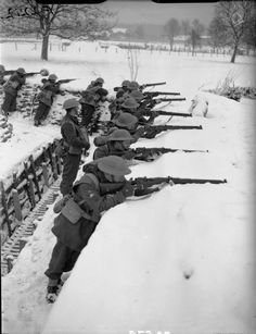 Men of the Battalion Royal Warwickshire Regiment manning a trench in the snow at Rumegies, 22 January