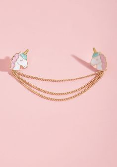 Every Which Neigh Enamel Collar Pin - Instead of searching every corner for the earth for a unicorn collar pin, it looks like you've found us first - congrats! To reward your efforts, we present you with this ModCloth exclusive, enamel accessory, whose glossy, pastel beasts and trio of draped gold chains are the exact treasures you've been seeking.